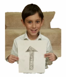 "The author's oldest son holds up a sign with an arrow pointing ""North"" with the word ""Carino"" embedded in the arrow."