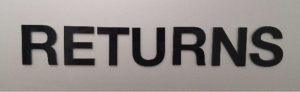 "The picture is of a metallic library sign with the word ""RETURNS"" in black lettering."