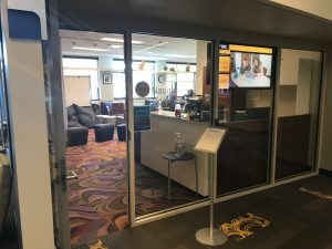 """Image 1: """"The glass front entrance of Georgia Tech's Naugle Communication Center gives the center a more open and accessible feeling"""""""